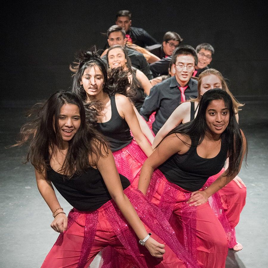 Performers dancing.