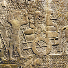 Ancient stone carving of people