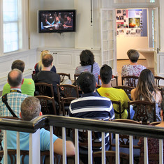 People watching a video at the Visitor Center.